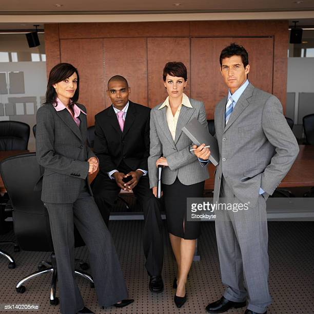 portrait of business executives standing together in an office
