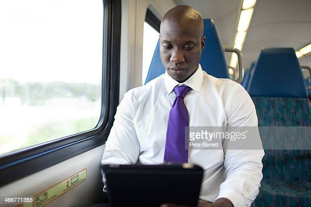 Portrait of business man riding on train alone
