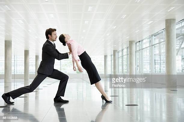 portrait of business man supporting business woman - trust stock pictures, royalty-free photos & images