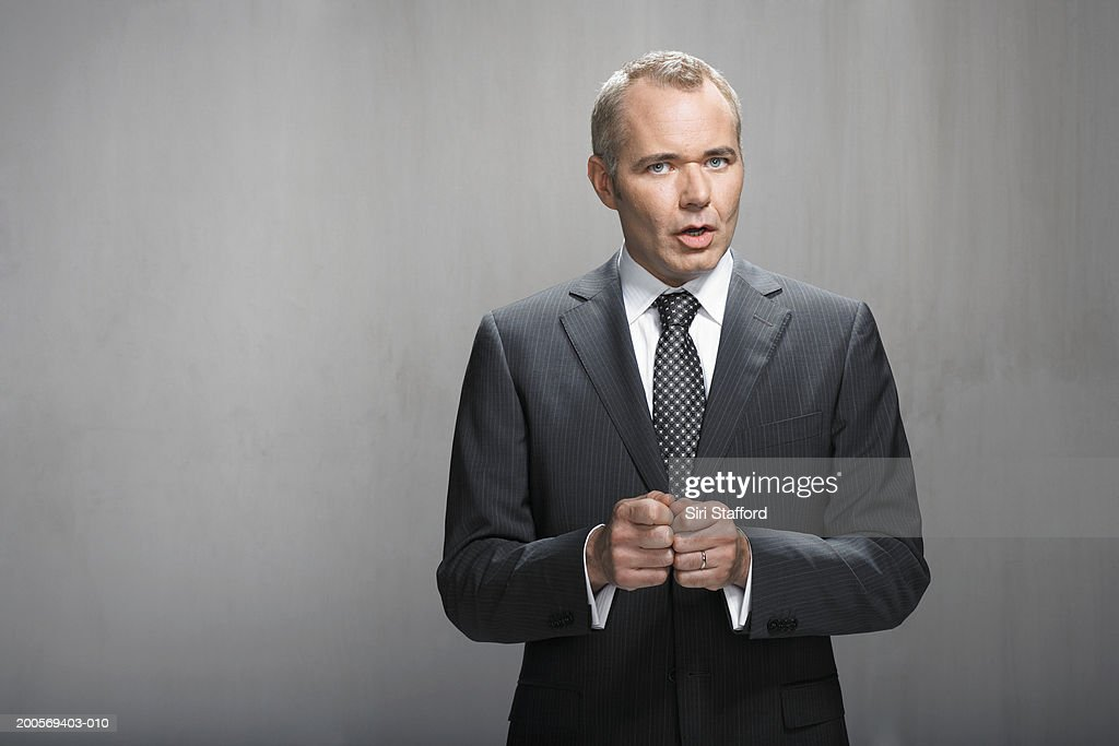 Portrait of business man talking : Stock Photo