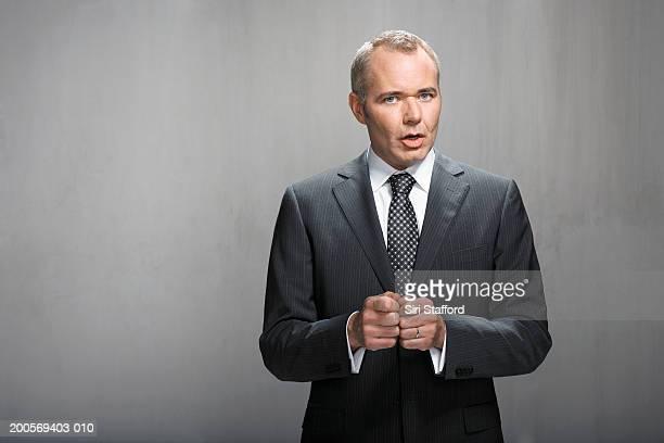 portrait of business man talking - homens de idade mediana imagens e fotografias de stock