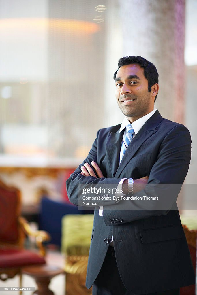 Portrait of business man with arms crossed : Foto stock