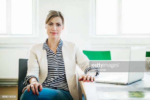 portrait of business owner at conference table - part of a series stock pictures, royalty-free photos & images