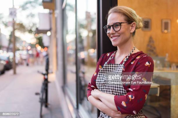 portrait of business owner standing outside cafe - cef do not delete stock pictures, royalty-free photos & images