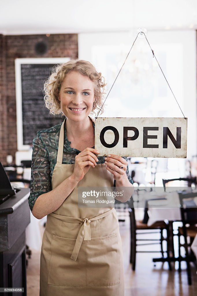 Portrait of business owner with open sign : Stockfoto
