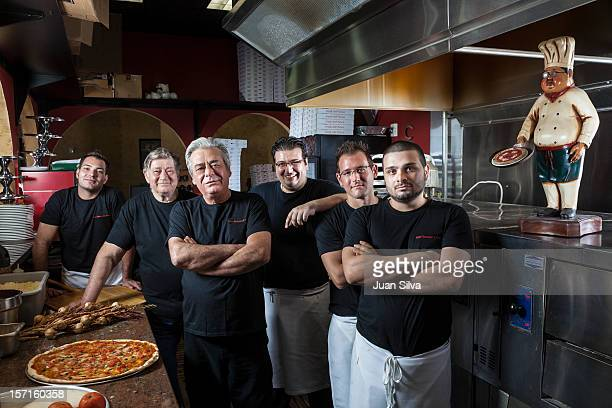 Portrait of business owners at pizza restaurant