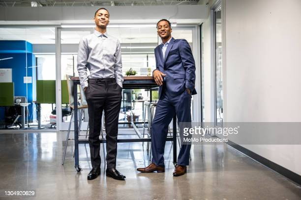 portrait of business owners in modern office - hands in pockets stock pictures, royalty-free photos & images
