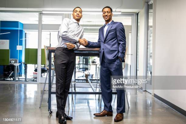 portrait of business owners in modern office - handshake stock pictures, royalty-free photos & images