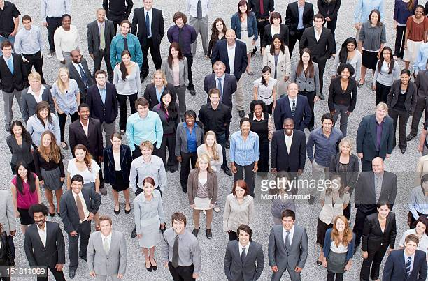 portrait of business people in crowd - crowd stock pictures, royalty-free photos & images