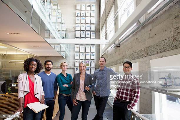 """portrait of business people in lobby - """"compassionate eye"""" stock pictures, royalty-free photos & images"""