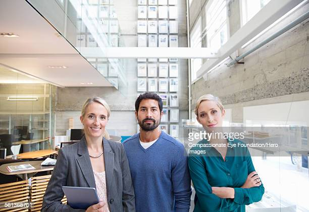 portrait of business people in lobby - leanintogether stock pictures, royalty-free photos & images