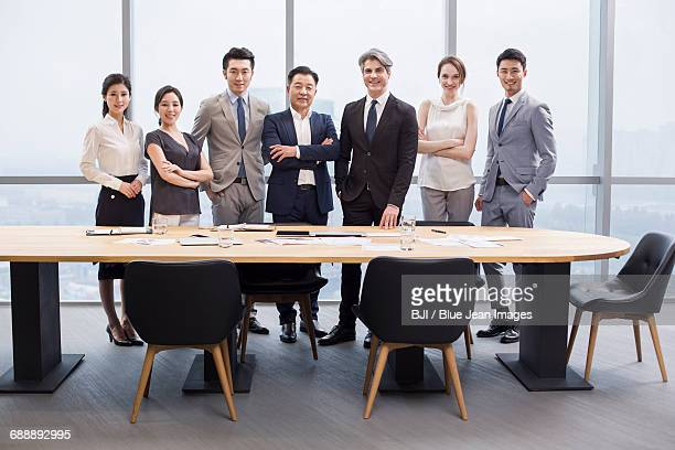 Portrait of business people in meeting room