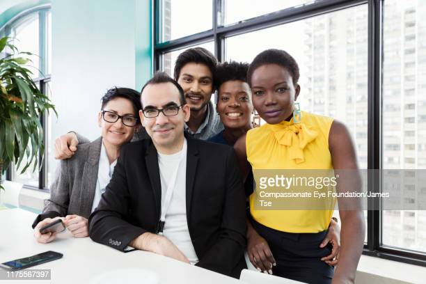 portrait of business people in modern office - photography stock pictures, royalty-free photos & images