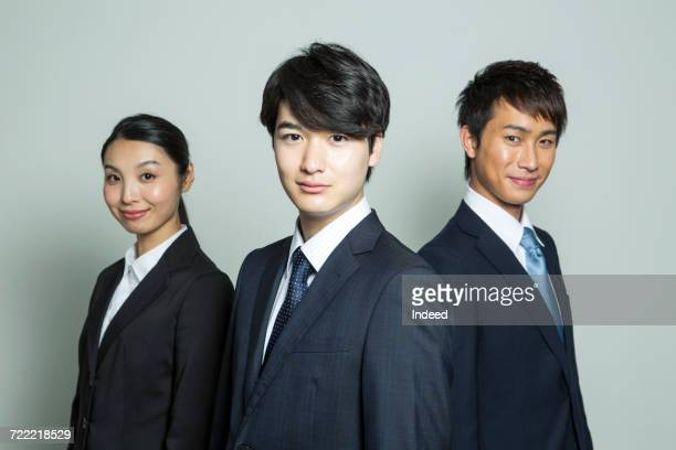 Portrait of business people, smiling