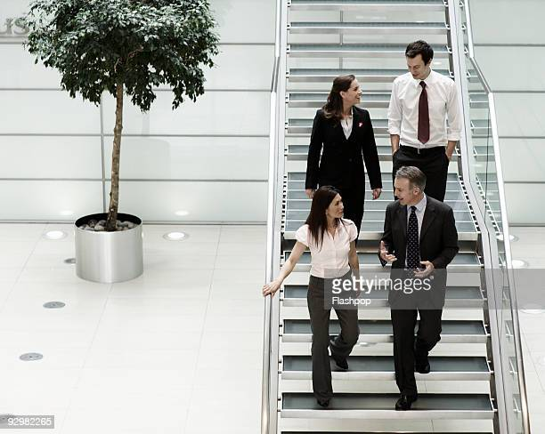 Portrait of business people walking and talking