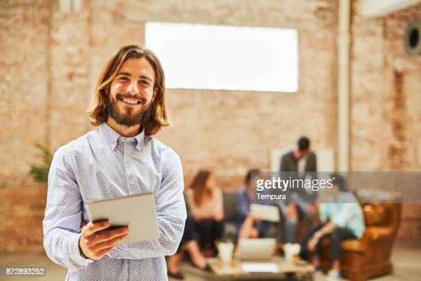 portrait of business person looking at camera. - creative director stock pictures, royalty-free photos & images