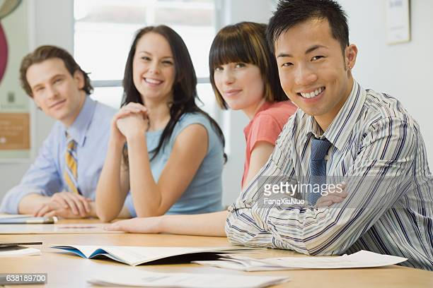 Portrait of business team in office meeting room