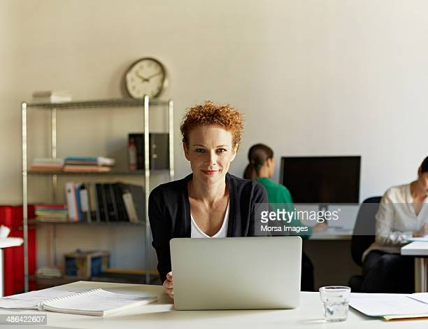 Portrait of business woman at work station