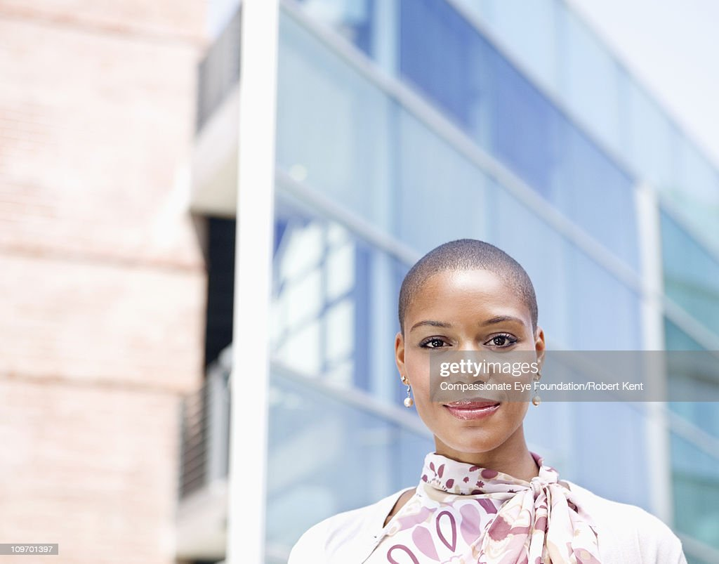 Portrait of business woman in front of building : Stock Photo