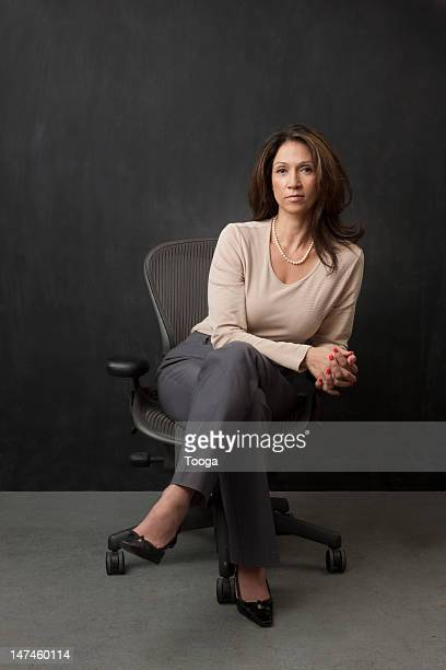 Portrait of business woman seated in chair