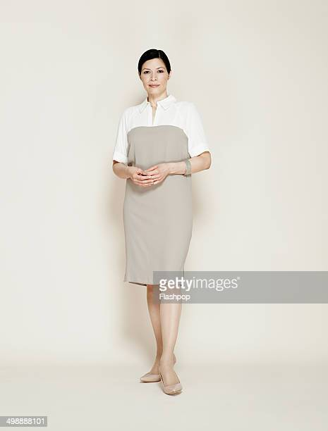 portrait of business woman smiling - staan stockfoto's en -beelden