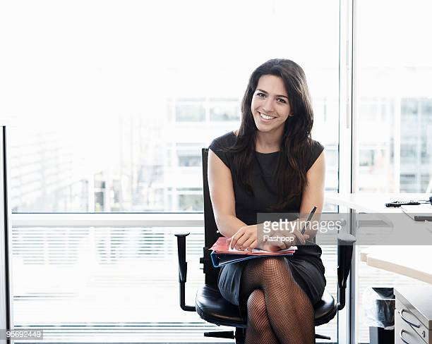portrait of business woman smiling  - businesswoman stock pictures, royalty-free photos & images