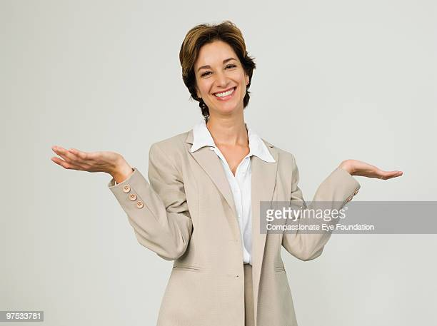 Portrait of business woman with her arms raised