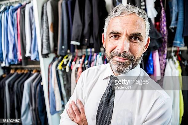 Portrait of businessman at his walk-in closet