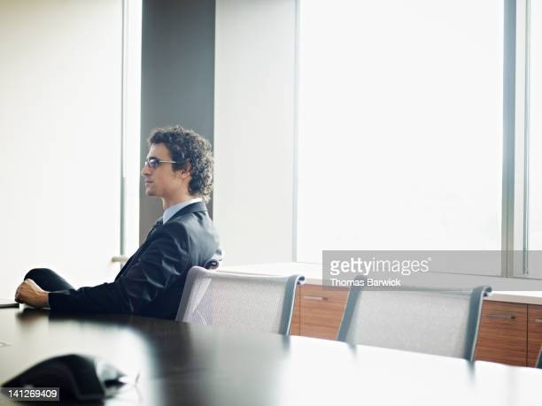 Portrait of businessman at office conference table