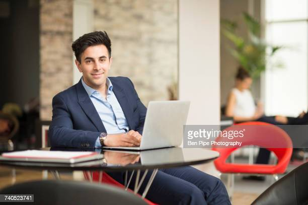 portrait of businessman at office desk - businesswear stock pictures, royalty-free photos & images