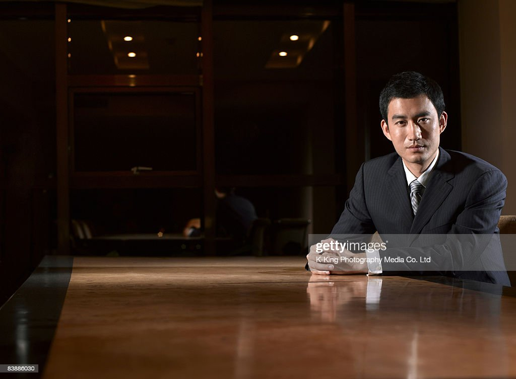 Portrait of businessman at table. : Stock Photo