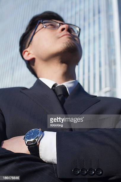 Portrait of businessman by the world trade center in Beijing, China