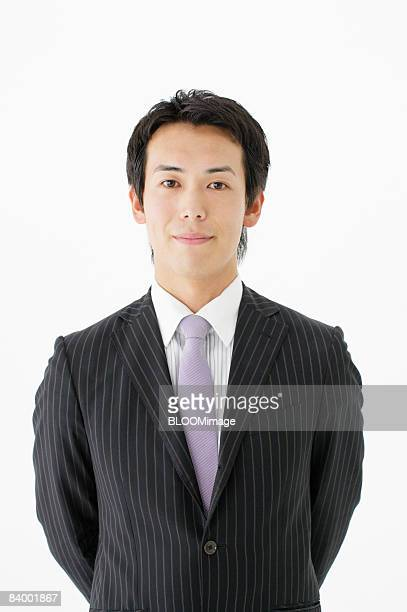 Portrait of businessman, close-up, studio shot