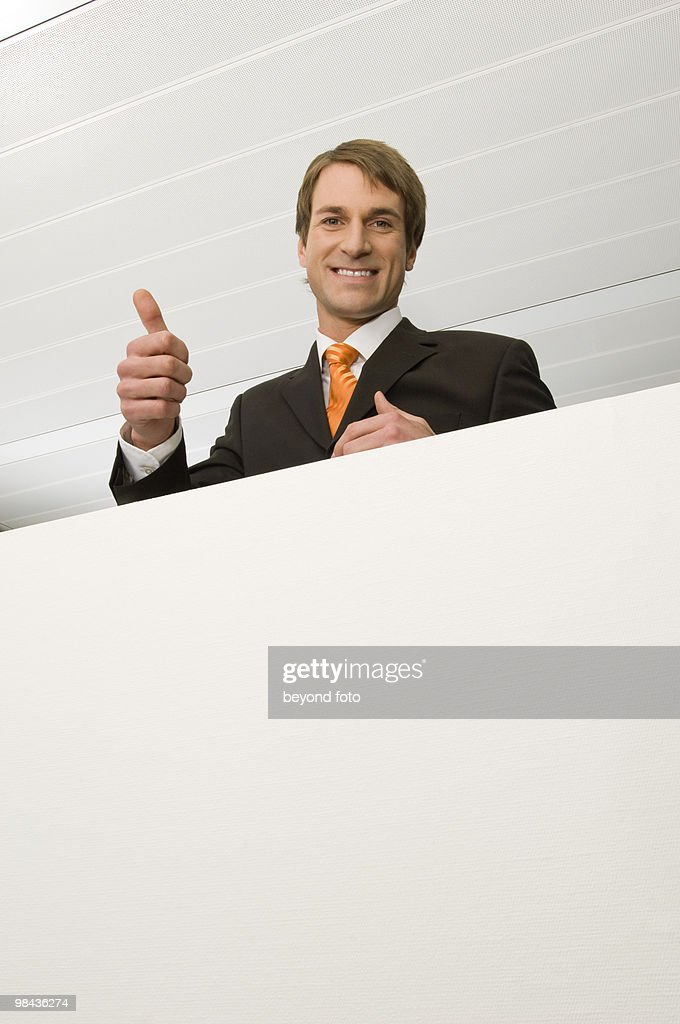 portrait of businessman doing the tumbs up sign stock photo getty