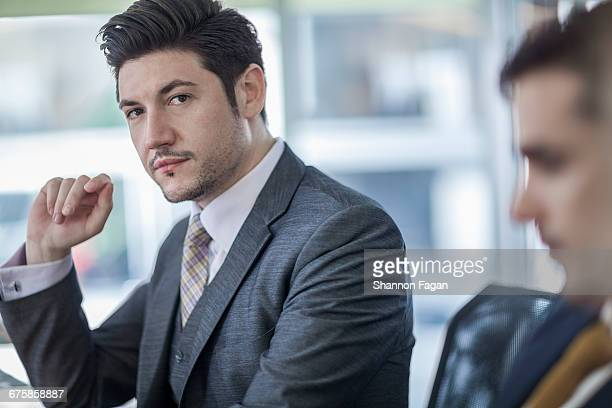 portrait of businessman during meeting - southern european descent stock pictures, royalty-free photos & images