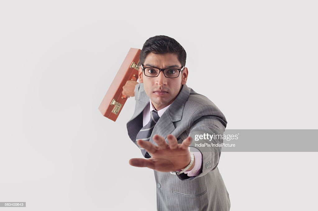 Portrait of businessman getting late : Stock Photo