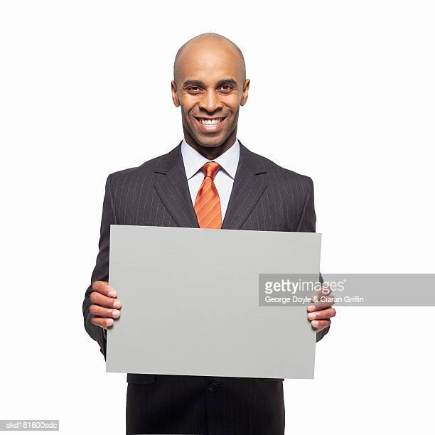 Portrait of businessman holding blank card