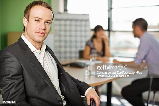 portrait of businessman in a conference room
