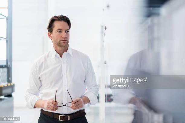Portrait of businessman in a factory