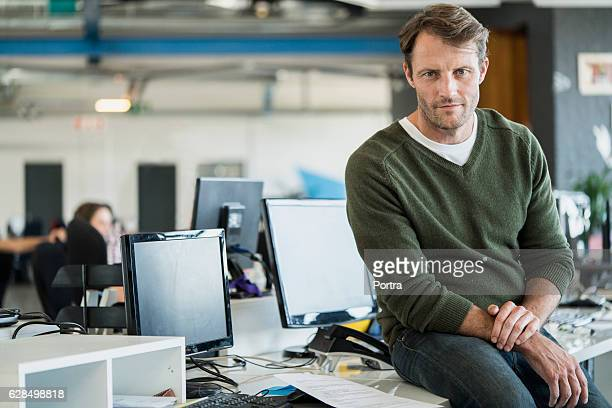 portrait of businessman in creative office - three quarter front view stock pictures, royalty-free photos & images
