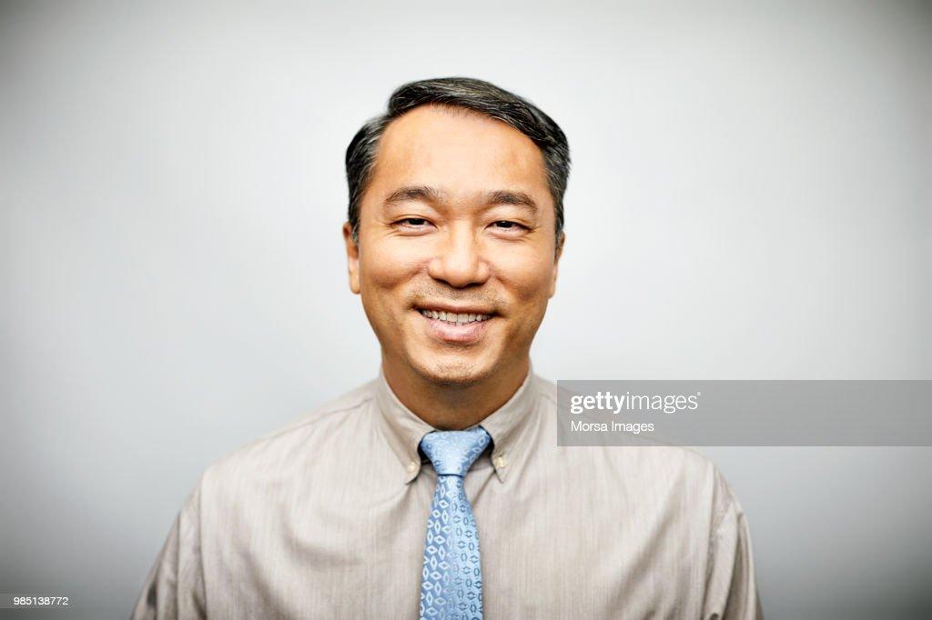 Portrait of businessman in formalwear smiling : Stock-Foto