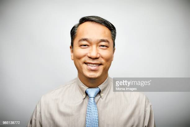 portrait of businessman in formalwear smiling - asien stock-fotos und bilder