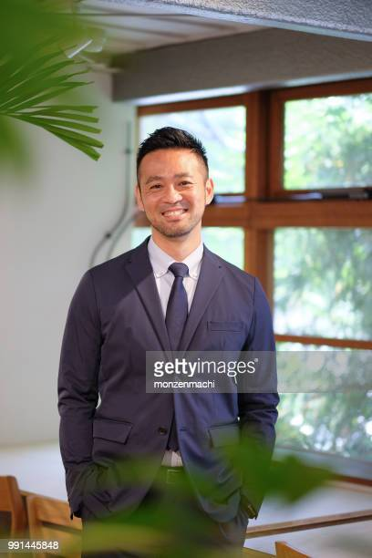 portrait of businessman in forties - managing director stock pictures, royalty-free photos & images