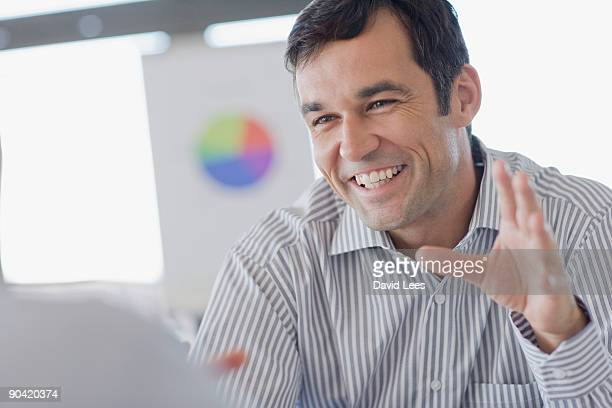 Portrait of businessman in meeting, smiling