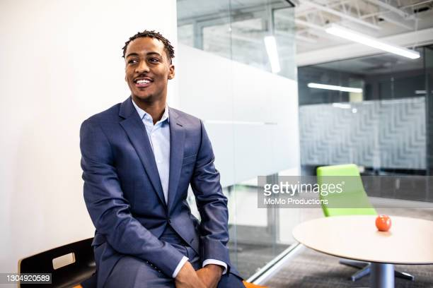 portrait of businessman in modern office - businessman stock pictures, royalty-free photos & images