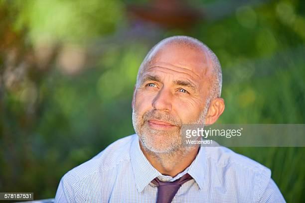 Portrait of businessman in nature