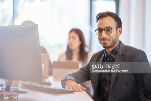 portrait of businessman in office - incidental people stock pictures, royalty-free photos & images