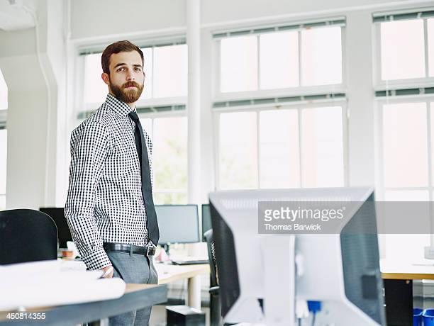 Portrait of businessman in office workstation