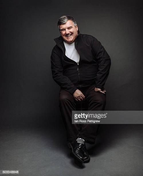 Portrait of businessman in studio, smiling