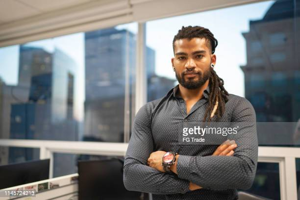 portrait of businessman in the office - dreadlocks stock pictures, royalty-free photos & images